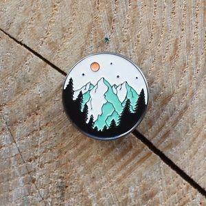Circle mountain trees moon and sky enamel pin